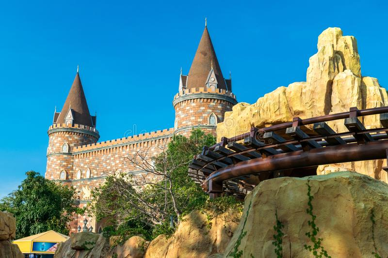 Rails and fairy castle in the amusement park under the evening sun. Rails and fairy castle in the amusement park under evening sun, blue, carousel, circle, day stock photo