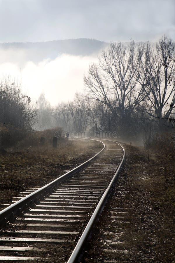 Rails in the fog. Rails in the mornign fog - slovakia stock photos