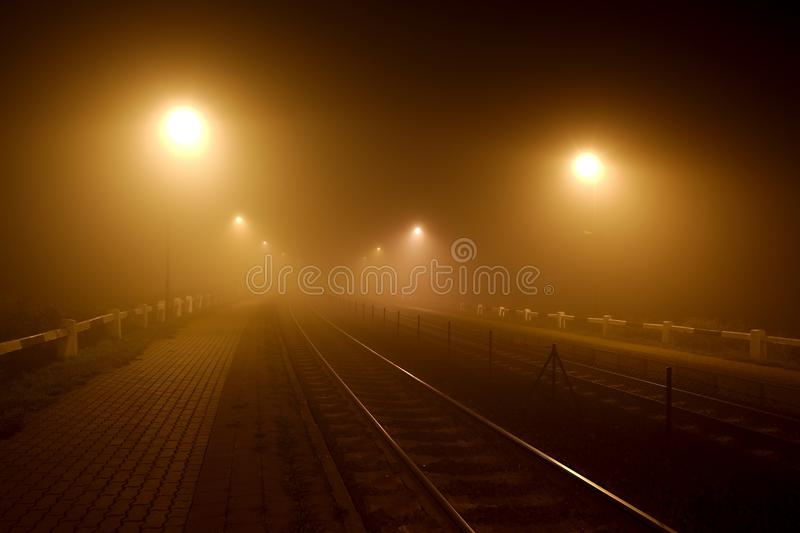 Rails in the fog. At night stock images