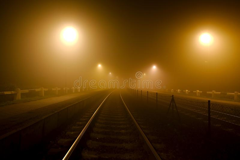Rails in the fog. At night stock image