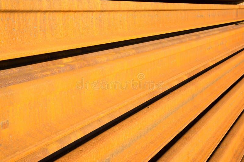 Rails. Full frame take of large rusty railroad rails stock image