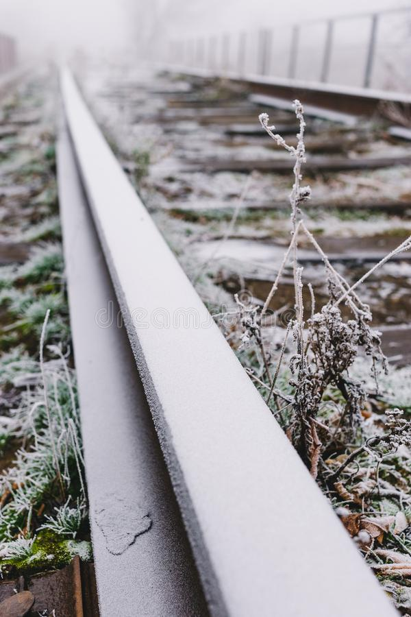 Rails in hoarfrost. Misty autumn morning.  royalty free stock image