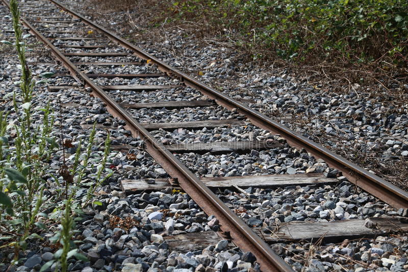 Rails. Old railway track a deserted backroad with ballast bed royalty free stock photo