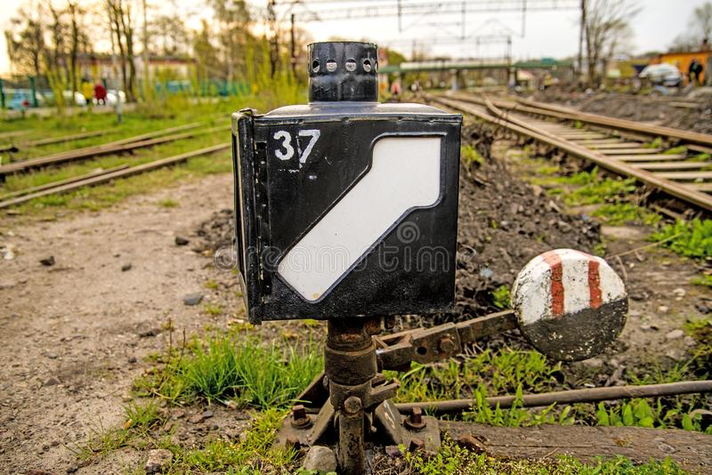 Rails out of order, switch. With green grass stock photos