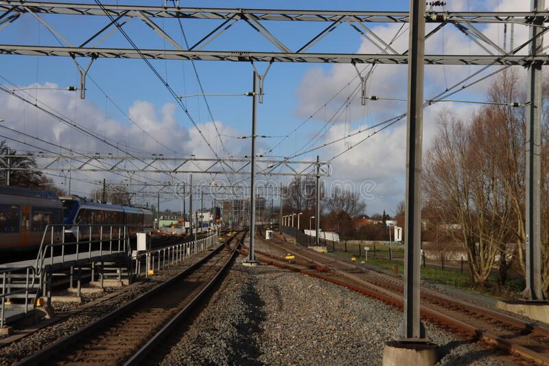 Rails and platform for street cars and trains to maintenance shop Leidschendam at station Forepark in The Hague royalty free stock images