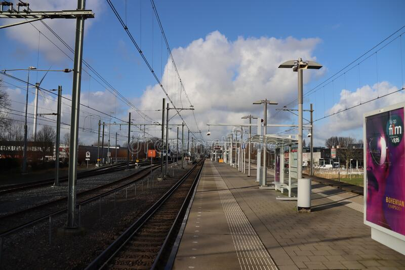 Rails and platform for street cars and trains to maintenance shop Leidschendam at station Forepark in The Hague stock images