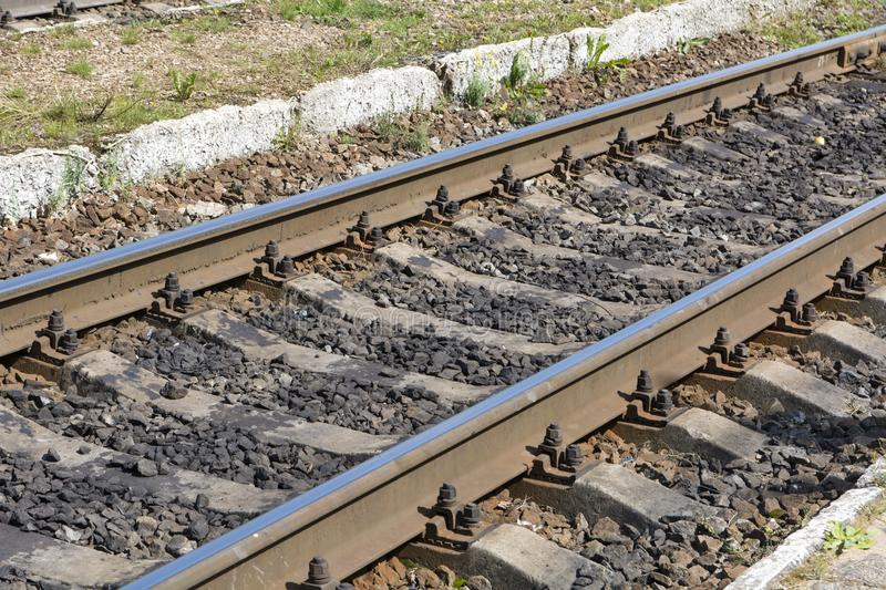 Rails. Railway section with rails and sleepers royalty free stock image