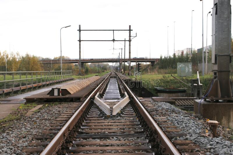 Rails on rotating train bridge over Gouwe canal with single track in Alphen aan den Rijn royalty free stock photography