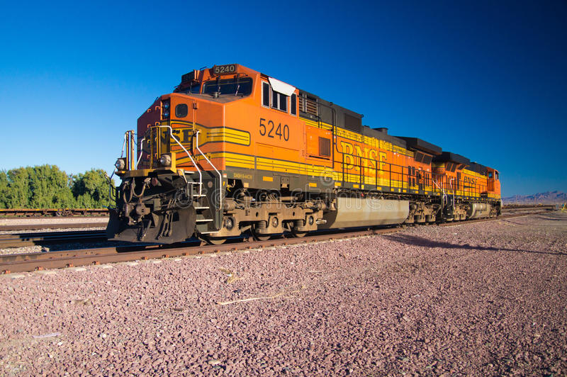 On the rails a stationary BNSF Freight Train Locomotive No. 5240. Distinctive orange and yellow Burlington Northern Santa Fe Locomotive freight train No. 5240 on royalty free stock photo