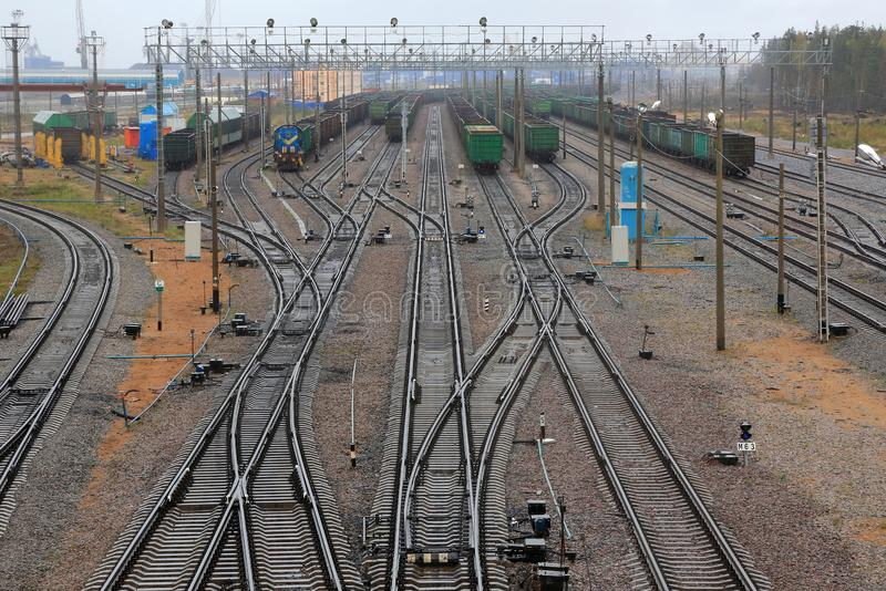 Rails and trains on the railway. The railway station and Carriages royalty free stock image