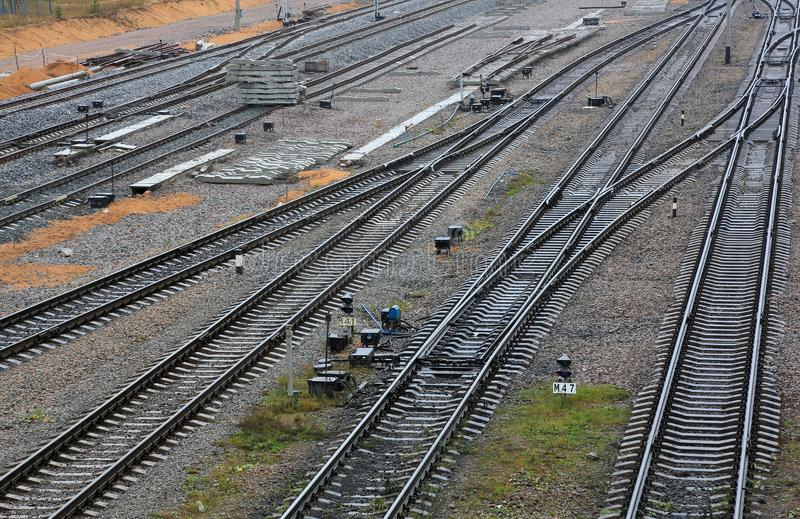 Rails and trains on the railway. The railway station and Carriages stock photography