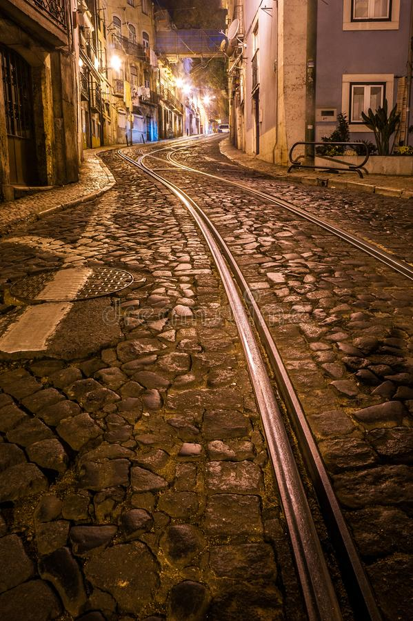 Rails of tram 28 through the Alfama district in Lisbon, Portugal royalty free stock photos