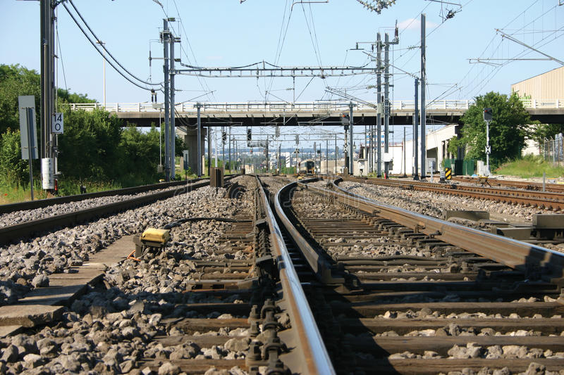 Railway. Picture taken on a european railway. Lots of electric cables mixed with a broad view of the rails royalty free stock image