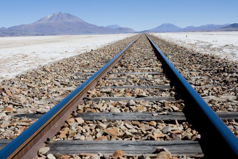 Railway across Salar de Uyuni royalty free stock photo
