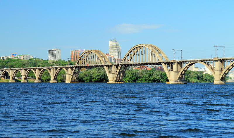 Railway arched bridge across the Dnieper River with a view of the Dnipro city. Dnepropetrovsk, Dnipropetrovsk, Dnepr, Ukraine royalty free stock image