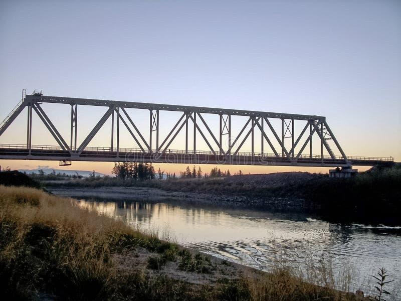 Railway bridge across the river. Steel. Construction royalty free stock images