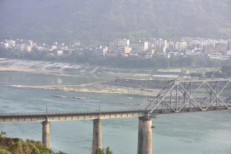 Railway bridge across the Yangtze river and the small town of scenery. The railway bridge across the Yangtze river and the small town of scenery!The royalty free stock image