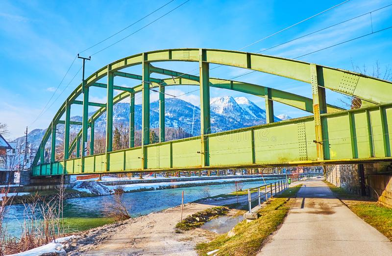 Railway bridge in Bad Ischl, Salzkammergut, Austria. The green arched railway bridge stretches across the Traun river in Bad Ischl, Salzkammergut, Austria royalty free stock photography