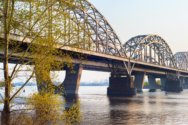 Railway bridge Dnipro river Kiev. Railway bridge over the Dnipro river at sunset. Kiev, Ukraine royalty free stock images