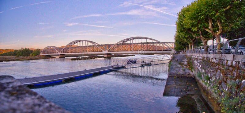 Railway bridge over Côa river at Caminha, Portugal stock image