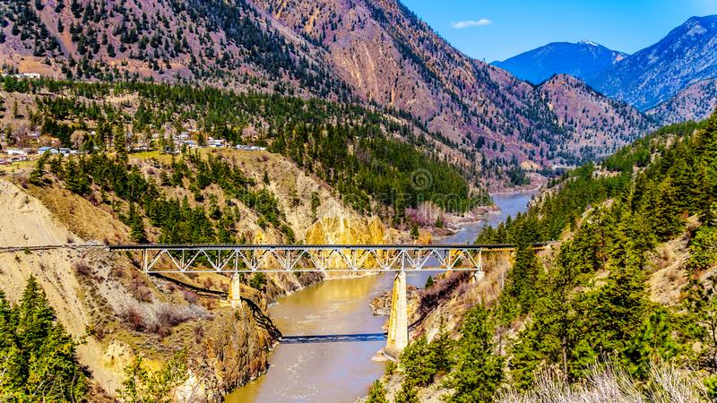 Railway bridge over the Fraser River in the Chilcotin region of BC, Canada royalty free stock photo
