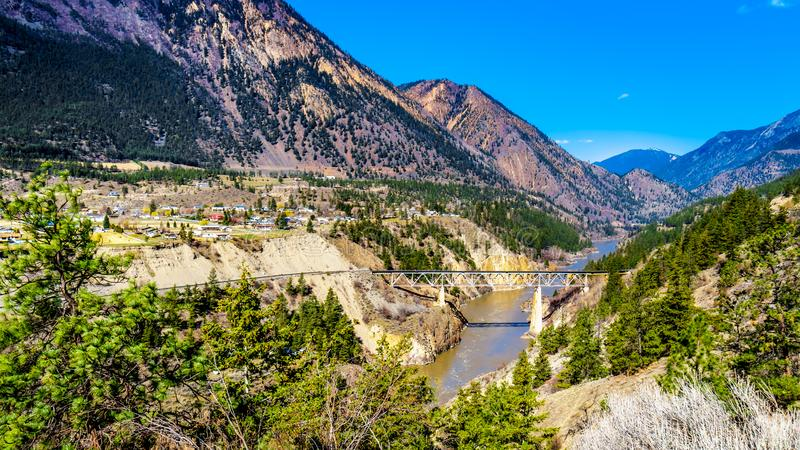 Railway bridge over the Fraser River in the Chilcotin region of BC, Canada royalty free stock image