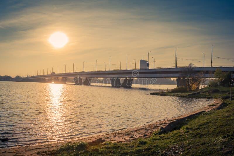 Railway bridge in Riga over the Daugava River in the fall in Oct. Bridge in Riga over the Daugava River in the fall in October on a sunny day, landscape stock photography