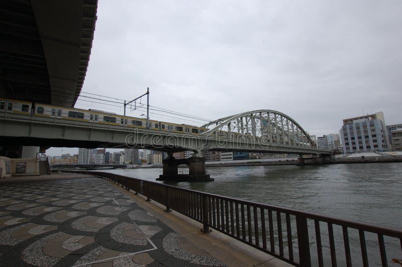 Railway bridge over the Sumida river, Tokyo royalty free stock photography