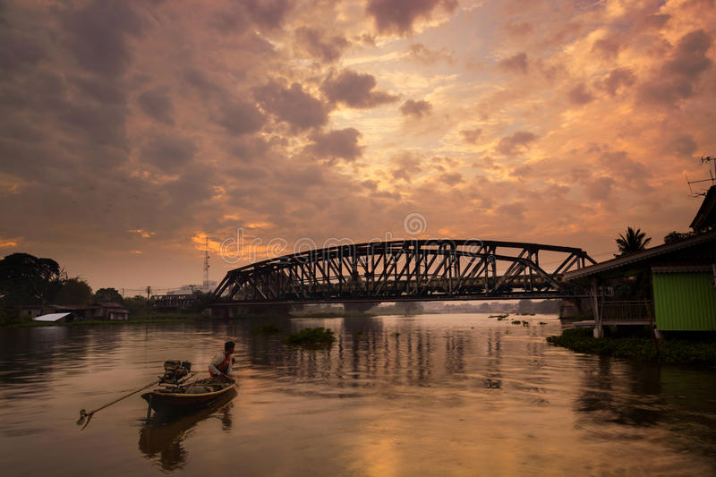 Railway Bridge with Train in Motion over Nakhon Chai Si River, N. Akhon Pathom in Thailand with Dramatic Color and lighting. Color Filter use in this image stock photo