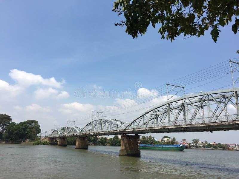 Railway bridge in Vietnam. Railway bridge across Nai river in Bien Hoa city, Nai, Vietnam royalty free stock photos