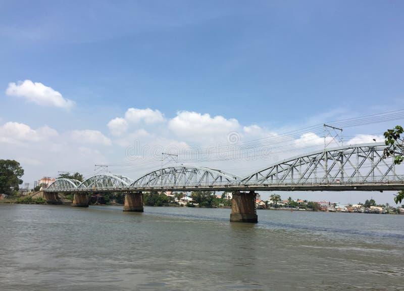 Railway bridge in Vietnam. View of the railway steel bridge across Nai river in Bien Hoa city, Nai, Vietnam royalty free stock image