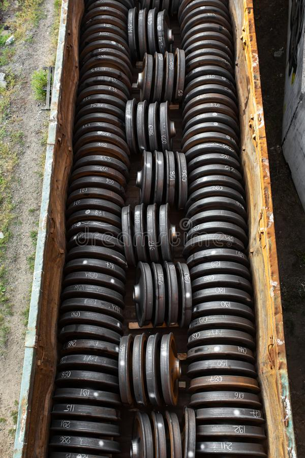 Railway carriage loaded with new train wheels.  stock photography