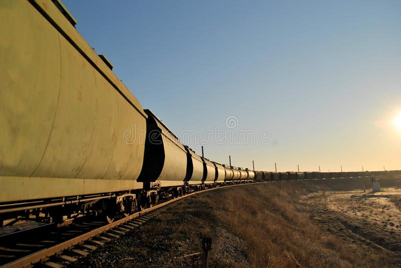 Railway composition in the rays of the morning sun against the blue sky. royalty free stock photos