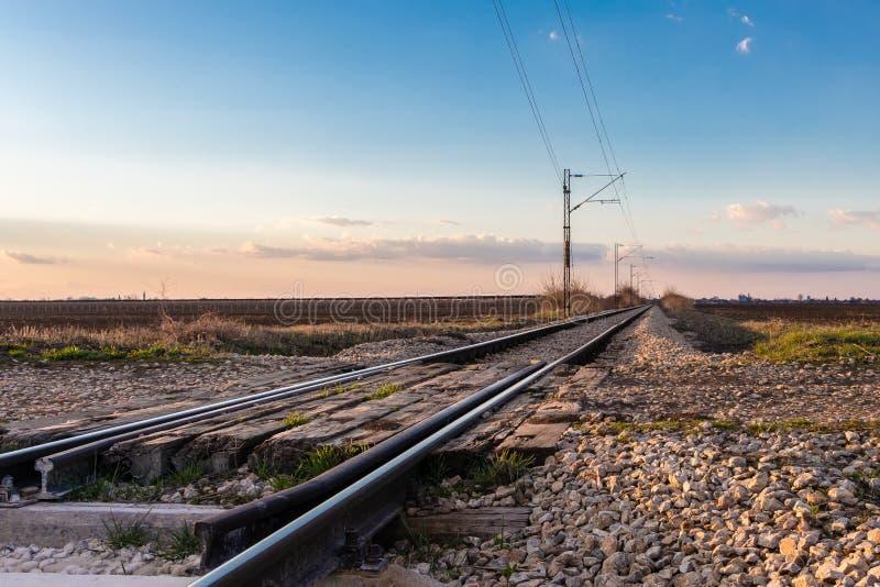 Railway crossing near Novi Sad in March, Serbia royalty free stock image