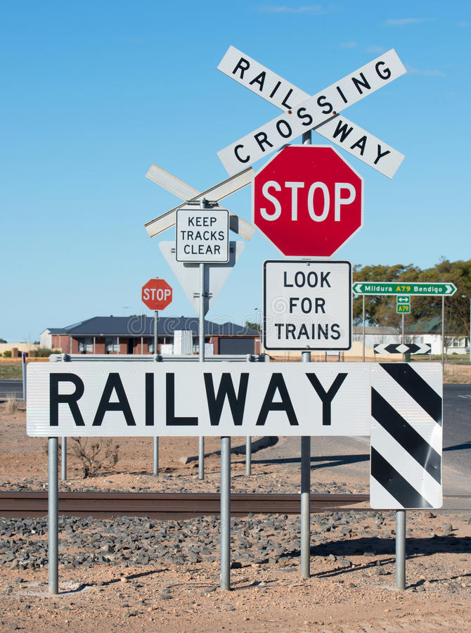 Railway Crossing Sign. At this railway crossing there are several signs for motorists to heed. They are Stop, Railway Crossing, Keep Tracks Clear, Railway stock photo