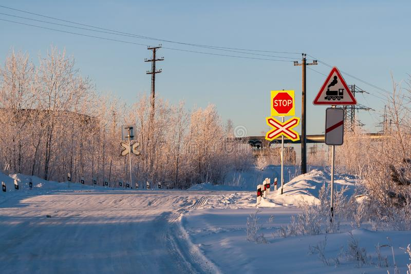 Railway crossing in winter. Road sign `railway crossing without barriers stock photography