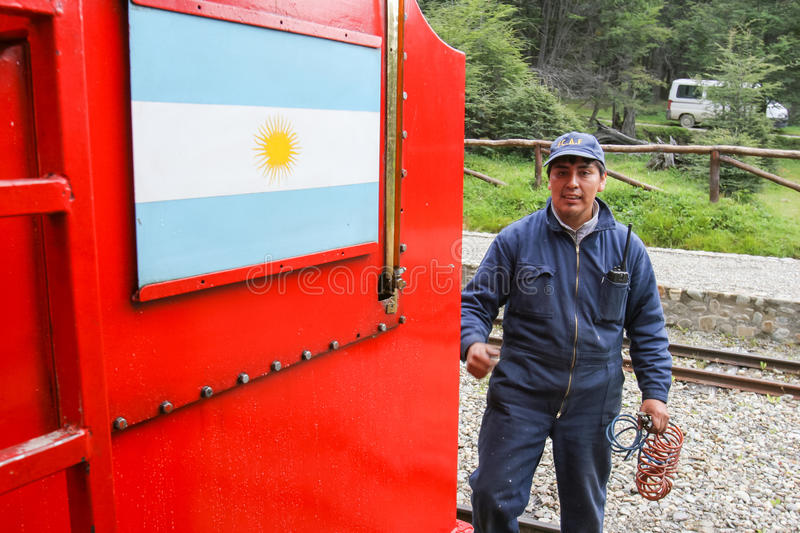 Railway employee. USHUAIA, ARGENTINA - FEBRUARY 2, 2006 : A railway employee standing at the station next to The Train of the End of the World in Ushuaia royalty free stock image