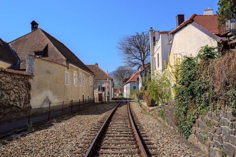 The railway through the fair municipality of Weissenkirchen in der Wachau. Lower Austria. stock photography