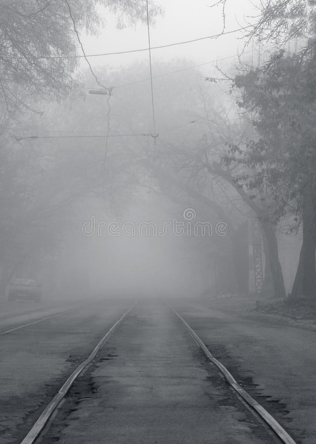 Railway going to fog. Railway rails going to fog stock photography