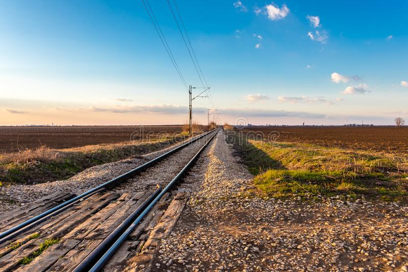 Railway line between the agricultural fields in March royalty free stock photography