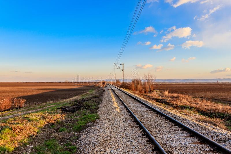 Railway line between the agricultural fields in March, Serbia royalty free stock photography