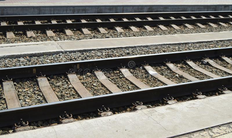 Railway lines for trains with rails, gravel and sleepers stock images