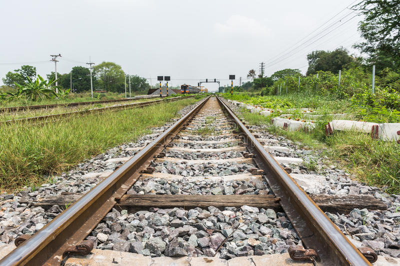 Railroad Tracks Converging Together Stock Photo - Download