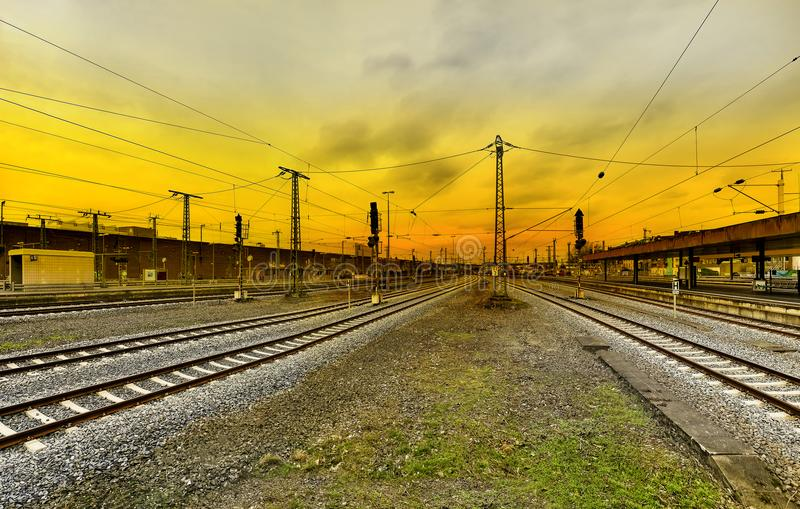 Railway platform tracks against the sunset. In Dusseldorf, Germany royalty free stock photography
