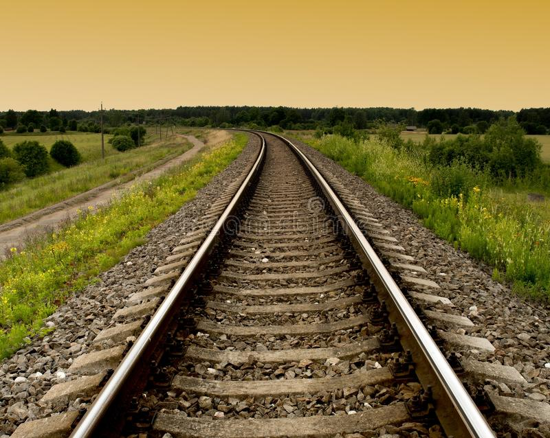 Railway rails turning to the left royalty free stock photography