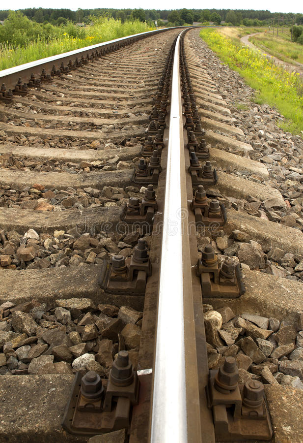 Railway rails turning to the right royalty free stock photo