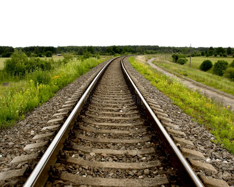 Railway rails turning to the right royalty free stock photography