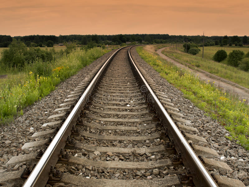 Railway rails turning to the right royalty free stock image