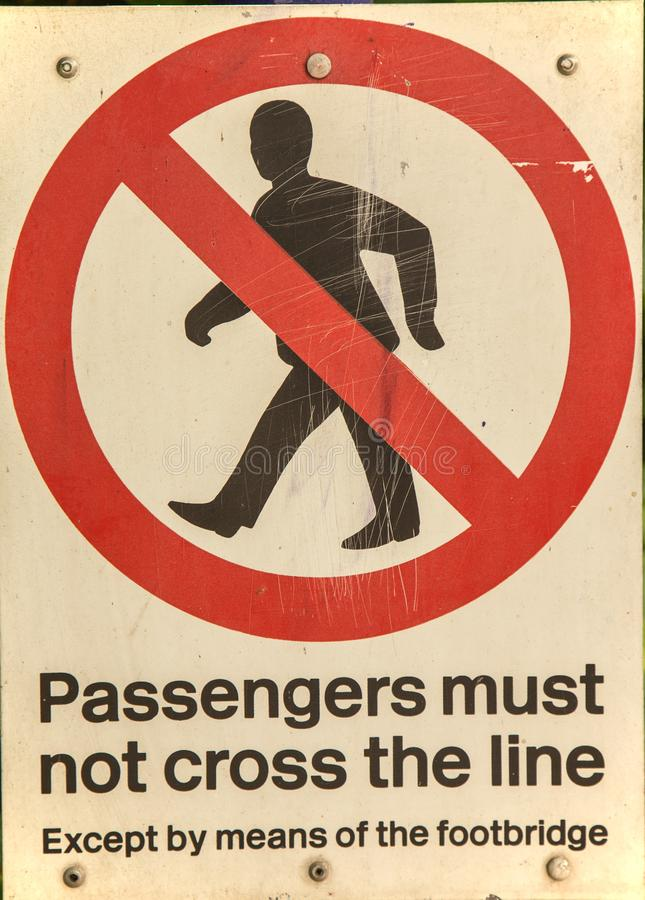 A railway sign warning passengers not to cross the line royalty free stock image