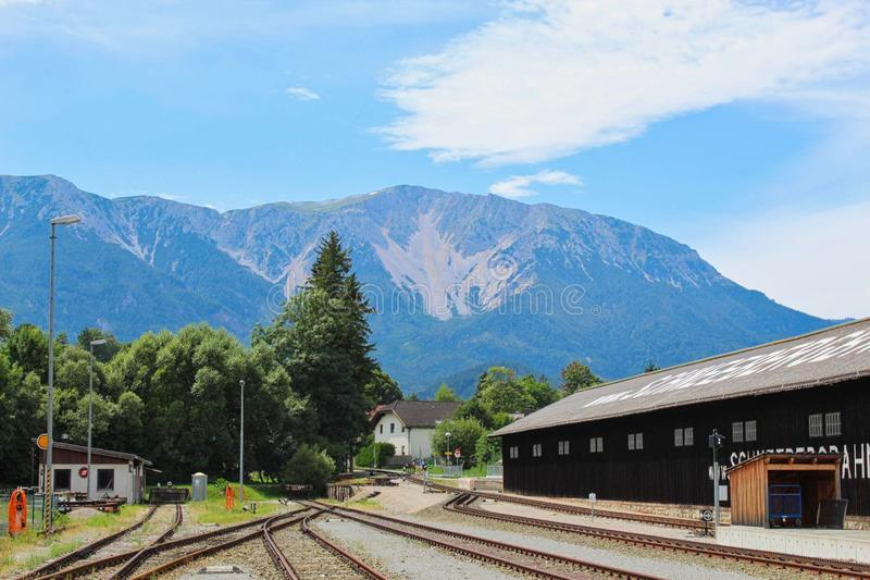 A railway station in front of a mountain. A railway station in front of the mountain, blue, destination, landmark, vacation, hiking, naye, montreux, nature, rock stock images